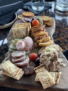 charcuterie board during happy hour