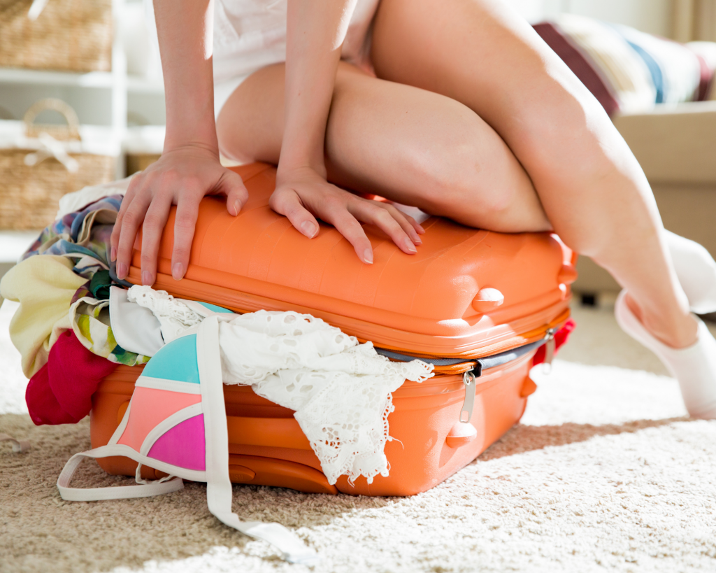 overpacked suitcase five things not to pack when traveling